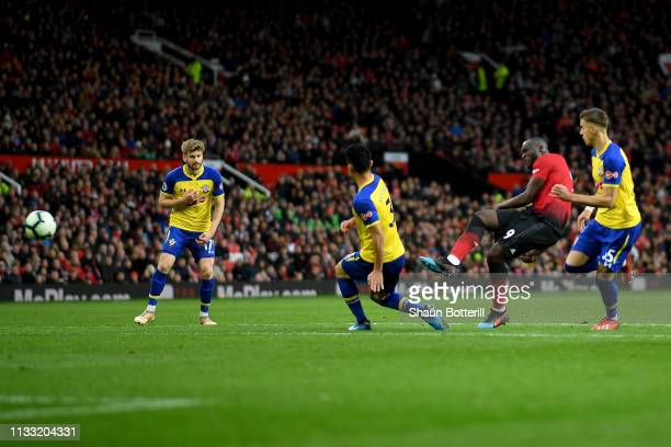 Romelu Lukaku of Manchester United scores his team's third goal during the Premier League match between Manchester United and Southampton FC at Old...
