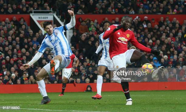 Romelu Lukaku of Manchester United scores their first goal during the Premier League match between Manchester United and Huddersfield Town at Old...