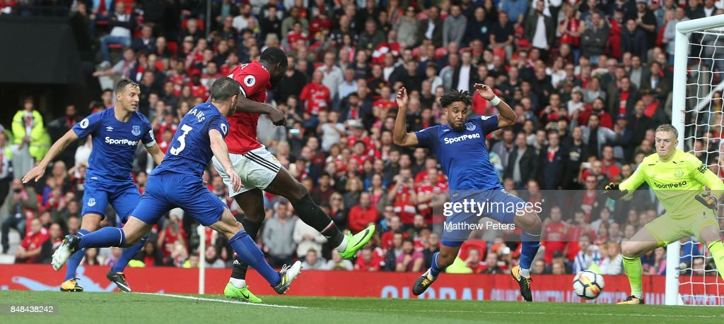 Romelu Lukaku of Manchester United scores their third goal during the Premier League match between Manchester United and Everton at Old Trafford on September 17, 2017 in Manchester, England.
