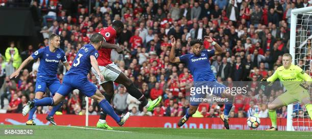 Romelu Lukaku of Manchester United scores their third goal during the Premier League match between Manchester United and Everton at Old Trafford on...
