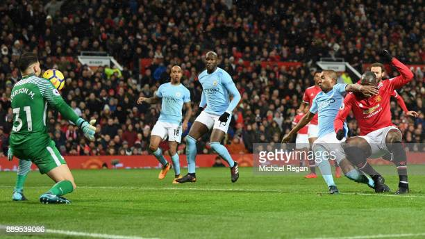 Romelu Lukaku of Manchester United sees his chance saved by Ederson of Manchester City during the Premier League match between Manchester United and...