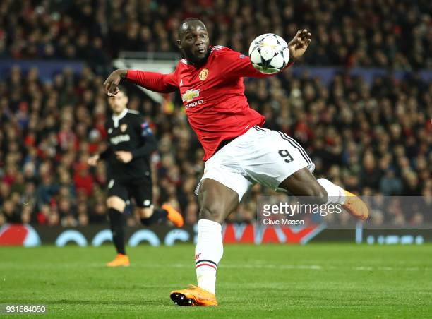 Romelu Lukaku of Manchester United shoots during the UEFA Champions League Round of 16 Second Leg match between Manchester United and Sevilla FC at...