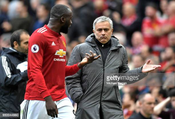 Romelu Lukaku of Manchester United speaks with Jose Mourinho during the Premier League match between Manchester United and Liverpool at Old Trafford...