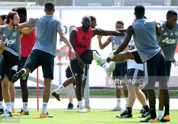Romelu Lukaku of Manchester United stretches with teammates during training for Tour 2017 at UCLA's Drake Stadium on July 10 2017 in Los Angeles...