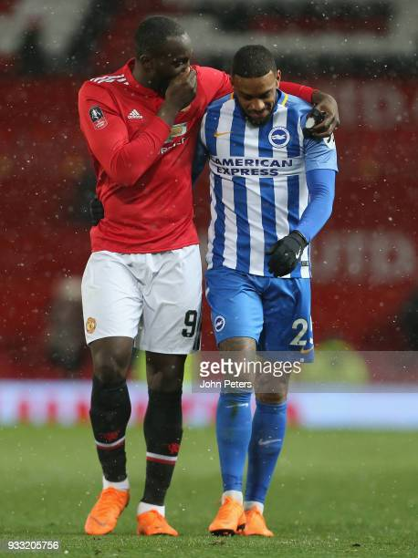 Romelu Lukaku of Manchester United walks off with Jurgen Locadia of Brighton Hove Albion after the Emirates FA Cup Quarter Final match between...