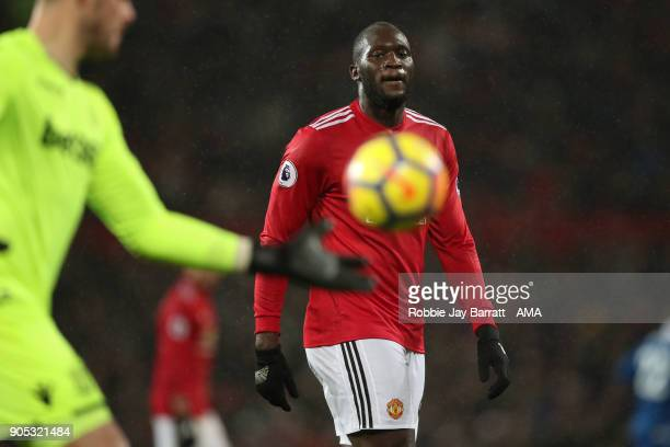 Romelu Lukaku of Manchester United watches over Jack Butland of Stoke City take a goal kick during the Premier League match between Manchester United...