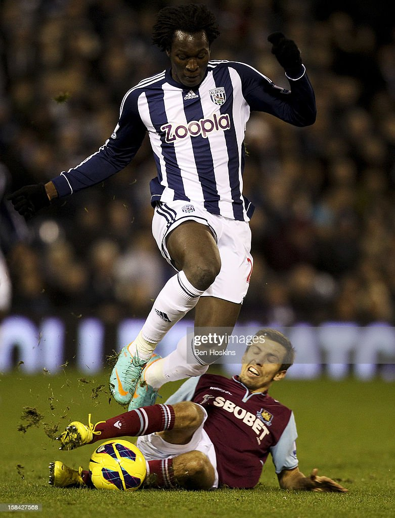 Romelu Lukaku of West Brom is tackled by Gary O'Neil of West Ham during the Barclays Premier League match between West Bromwich Albion and West Ham United at the Hawthorns on December 16, 2012 in West Bromwich, England.