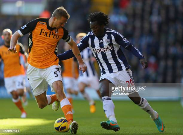 Romelu Lukaku of West Bromwich Albion tackles Brede Hangeland of Fulham during the Barclays Premier League match between West Bromwich Albion and...