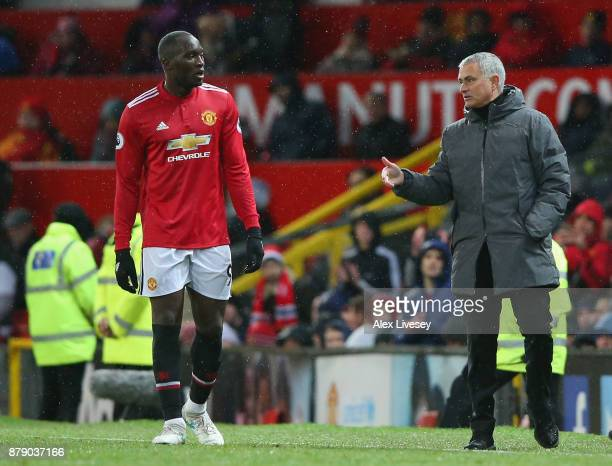 Romelu Lukaku speaks with Jose Mourinho Manager of Manchester United during the Premier League match between Manchester United and Brighton and Hove...