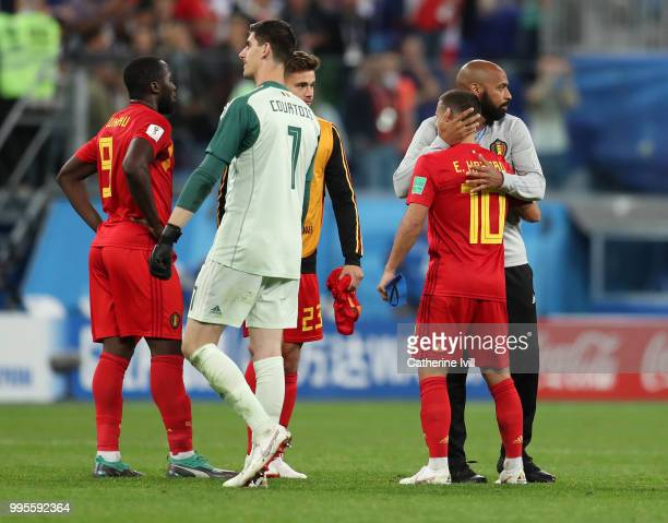 Romelu Lukaku Thibaut Courtois Leander Dendoncker Eden Hazard of Belgium and assistant coach Thierry Henry look dejected following their sides defeat...