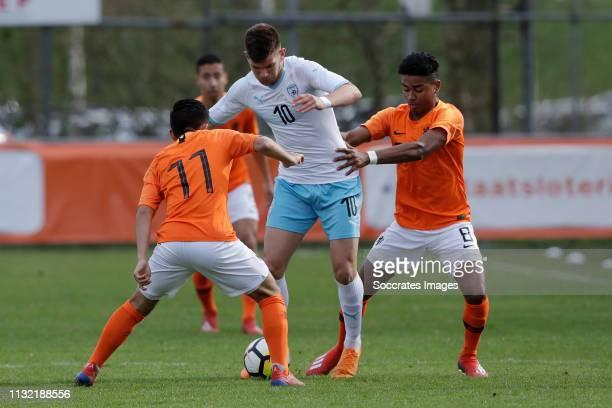 Romen Hanzis of Israel U17 Ian Maatsen of Holland U17 during the match between Holland U17 v Israel U17 at the Sportpark Zegersloot on March 23 2019...