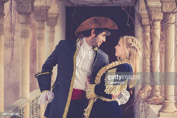 romeo and juliet embracing at balcony - historical romance stock photos and pictures