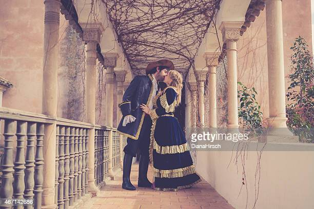 romeo and juliet kissing juliets at beautiful balcony - historical romance stock photos and pictures