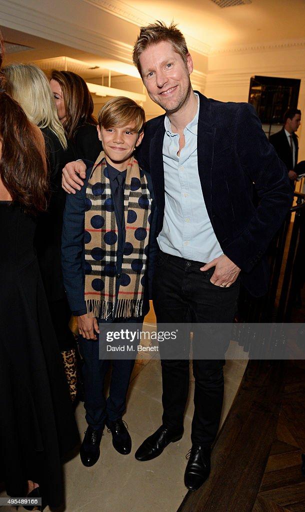 Romeo Beckham (L) and Christopher Beckham attend the Burberry Festive film premiere at 121 Regent Street on November 3, 2015 in London, England.