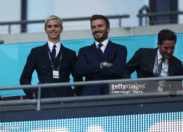 Romeo Beckham and David Beckham, Former England International react as they watch on from the stands during the UEFA Euro 2020 Championship Group D...