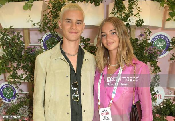 Romeo Beckham and Mia Regan pose in evian's VIP suite, certified as carbon neutral by The Carbon Trust, during day one of The Championships,...