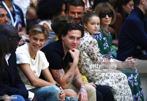 Romeo Beckham Brooklyn Beckham David Beckham Harper Seven Beckham and Anna Wintour attend the Victoria Beckham show during London Fashion Week...