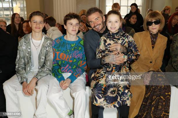 Romeo Beckham Cruz Beckham David Beckham Harper Beckham and Anna Wintour attend the Victoria Beckham show during London Fashion Week February 2020 on...