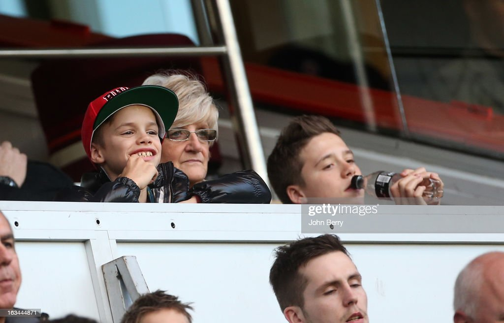 Romeo Beckham, David Beckham's mother Sandra Beckham and Brooklyn Beckham watch the french Ligue 1 match between Paris Saint-Germain FC and AS Nancy-Lorraine ASNL at the Parc des Princes stadium on March 9, 2013 in Paris, France.