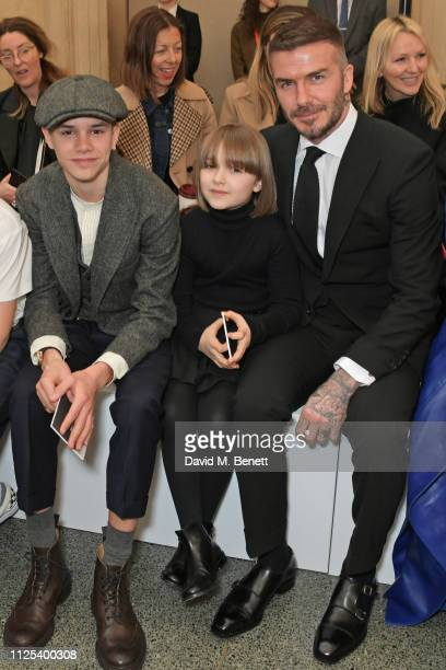 Romeo Beckham Harper Beckham and David Beckham attend the Victoria Beckham show during London Fashion Week February 2019 at Tate Britain on February...