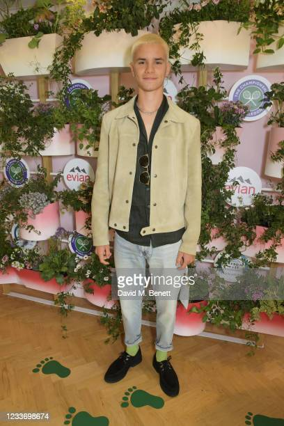 Romeo Beckham poses in evian's VIP suite, certified as carbon neutral by The Carbon Trust, during day one of The Championships, Wimbledon 2021 on...