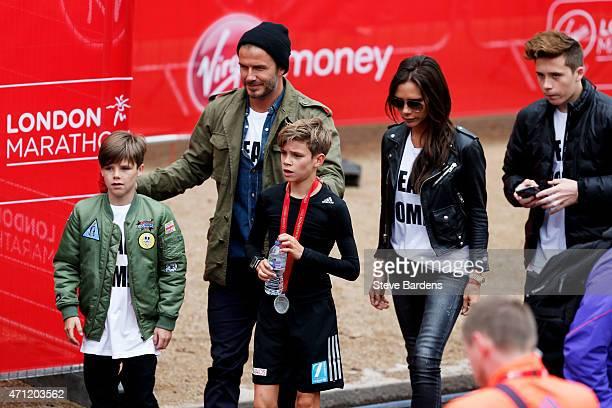 Romeo Beckham receives the support of his family brother Cruz Beckham father David Beckham mother Victoria Beckham and brother Brooklyn Beckham after...
