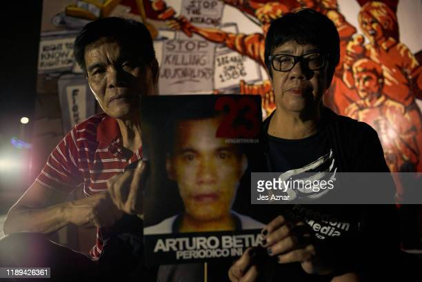 Romeo Betia and Emily Lopez sibling of murdered journalist join other journalists and activists as they gather to hold a vigil on the eve of the...