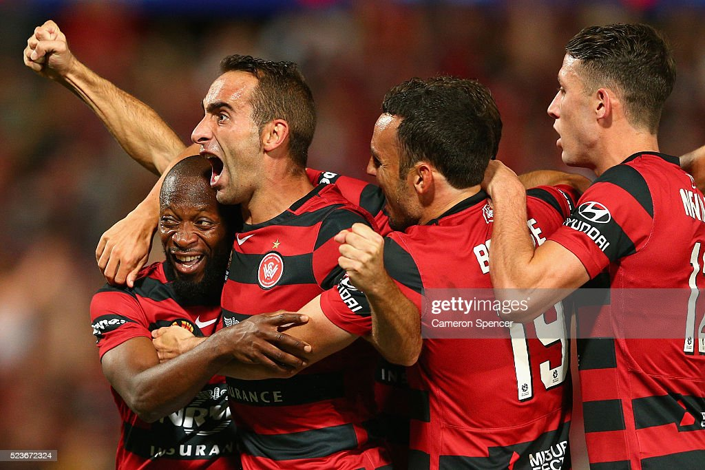 Romeo Castelen of the Wanderers celebrates with team mates after scoring a goal during the A-League Semi Final match between the Western Sydney Wanderers and the Brisbane Roar at Pirtek Stadium on April 24, 2016 in Sydney, Australia.