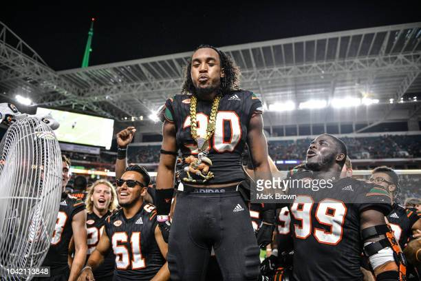 Romeo Finley of the Miami Hurricanes displays the Turnover Chain on the bench after running back an interception for a touchdown in the fourth...