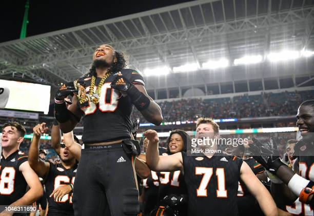 Romeo Finley of the Miami Hurricanes displays The Turnover Chain during the game against the North Carolina Tar Heels at Hard Rock Stadium on...
