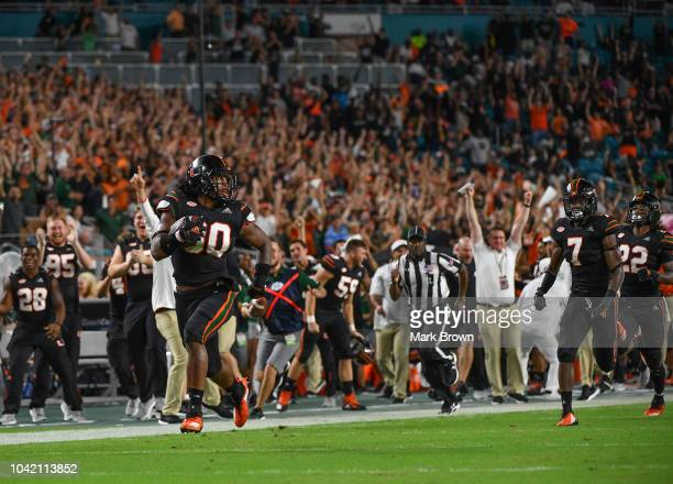 Romeo Finley of the Miami Hurricanes runs back an interception for a touchdown in the fourth quarter against the North Carolina Tar Heels at Hard...