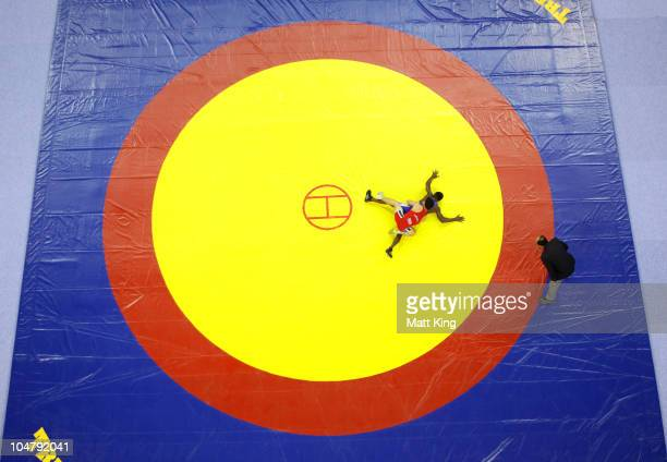 Romeo Joseph of Nigeria competes against Marius Loots of South Africa in the Greco-Roman 60 kg repechage final bout at the Inidra Ghandi Sports...