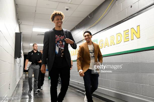 Romeo Langford and Tremont Waters of the Boston Celtics walk out prior to a game against the Toronto Raptors on October 25 2019 at the TD Garden in...