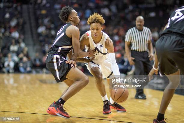 Romeo Langford New Albany HS New Albany IN drives to the basket defended by Javonte Smart Scotlandville Magnet HS Barton Rouge LA during the Jordan...