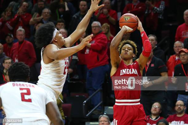 Romeo Langford of the Indiana Hoosiers attempts a shot as Ron Harper Jr #24 of the Rutgers Scarlet Knights defends during the second half of a game...