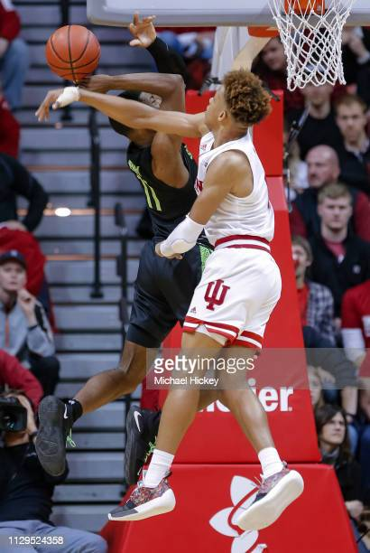 Romeo Langford of the Indiana Hoosiers blocks the shot of Aaron Henry of the Michigan State Spartans at Assembly Hall on March 2, 2019 in...