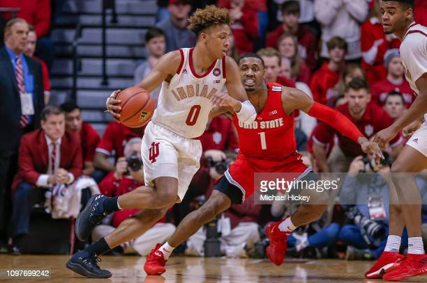 Romeo Langford of the Indiana Hoosiers dribbles the ball against Luther Muhammad of the Ohio State Buckeyes at Assembly Hall on February 10 2019 in...