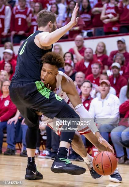 Romeo Langford of the Indiana Hoosiers drives to the basket against Kyle Ahrens of the Michigan State Spartans at Assembly Hall on March 2, 2019 in...