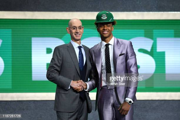 Romeo Langford poses with NBA Commissioner Adam Silver after being drafted with the 14th overall pick by the Boston Celtics during the 2019 NBA Draft...