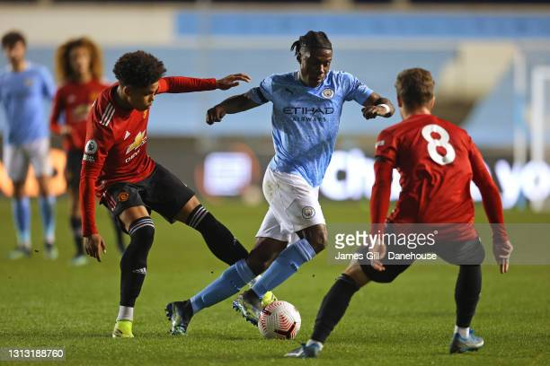 Romeo Lavia of Manchester City beats Shola Shoretire of Manchester United during the Premier League 2 match between Manchester City and Manchester...