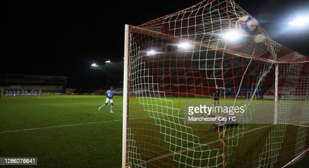 Romeo Lavia of Manchester City U21 scores from the penalty spot during the EFL Trophy match between Lincoln City and Manchester City U21 at Sincil...
