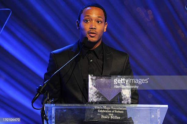 Romeo Miller presents his father rapper/producer Percy Miller an award during a Celebration of All Fathers' Gala Dinner with Andrea Bocelli at...