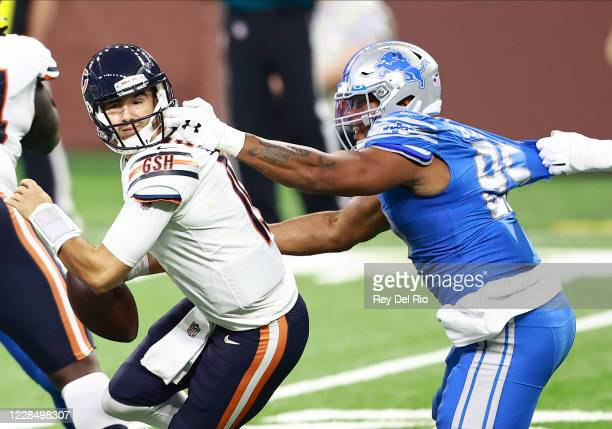 Romeo Okwara of the Detroit Lions grabs the facemask of Mitchell Trubisky of the Chicago Bears in the fourth quarter at Ford Field on September 13,...