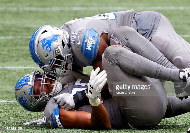 Romeo Okwara of the Detroit Lions is congratulated by Jarrad Davis after sacking Matt Ryan of the Atlanta Falcons during the second half at...