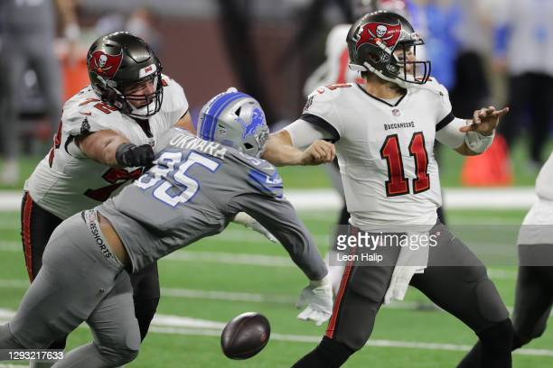 Romeo Okwara of the Detroit Lions strips the ball from Blaine Gabbert of the Tampa Bay Buccaneers during the fourth quarter of a game at Ford Field...