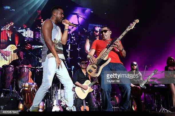 Romeo Santos and Max Santos of Aventura perform in concert at Yankee Stadium on July 12 2014 in New York City