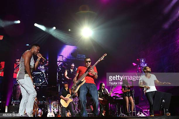 Romeo Santos Max Santos and Lenny Santos of Aventura perform in concert at Yankee Stadium on July 12 2014 in New York City
