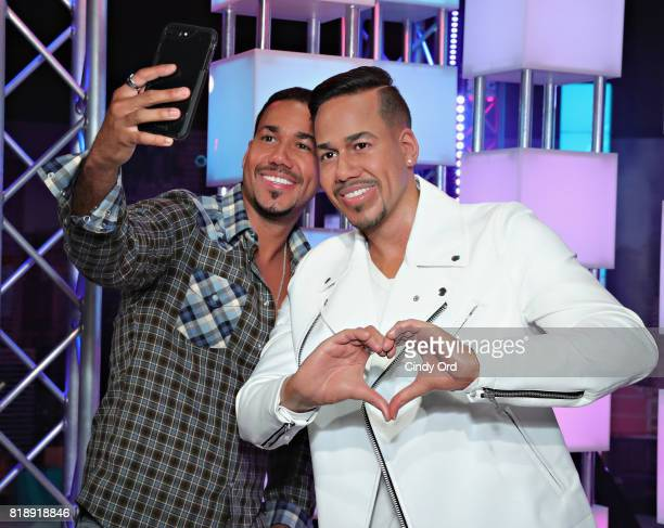 Romeo Santos meets his wax figure at the opening of Sabor Latino music experience at Madame Tussauds New York on July 19 2017 in New York City