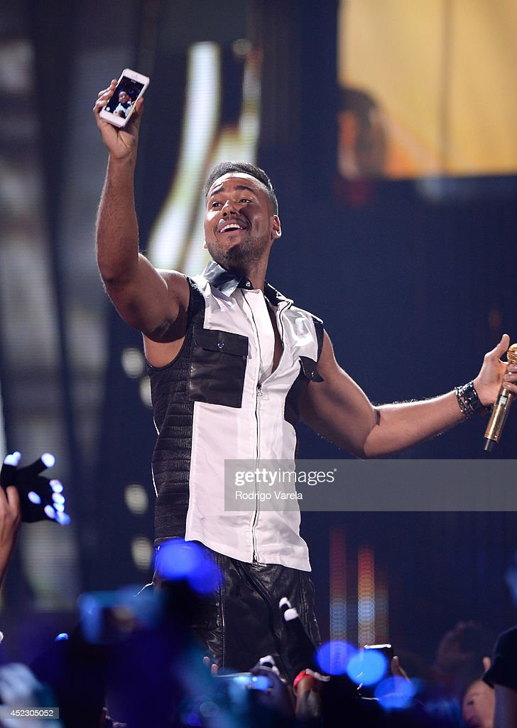 Romeo Santos performs onstage during the Premios Juventud 2014 at The BankUnited Center on July 17, 2014 in Coral Gables, Florida.