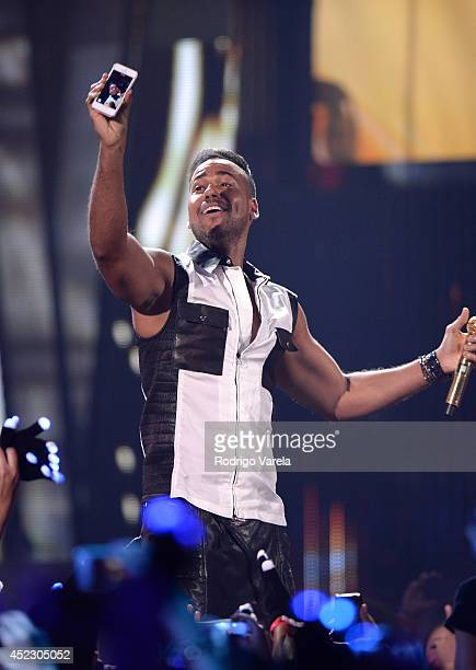 Romeo Santos performs onstage during the Premios Juventud 2014 at The BankUnited Center on July 17 2014 in Coral Gables Florida